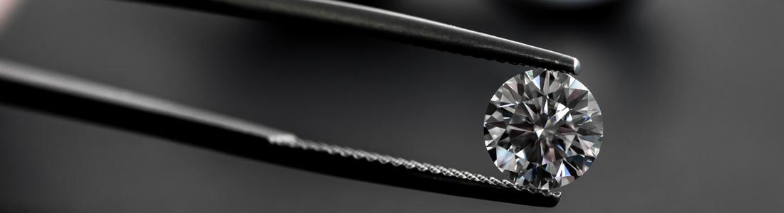 nasielski diamonds single stone in tweezers